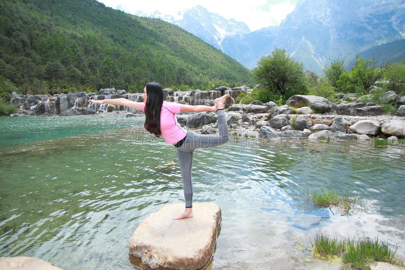 Peaceful happy life, careless Asian Chinese woman yoga stock images