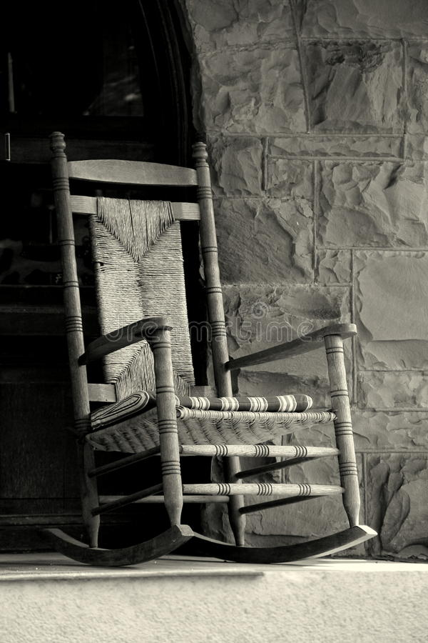 Two Black Rocking Chairs On A Quiet Porch Stock Image