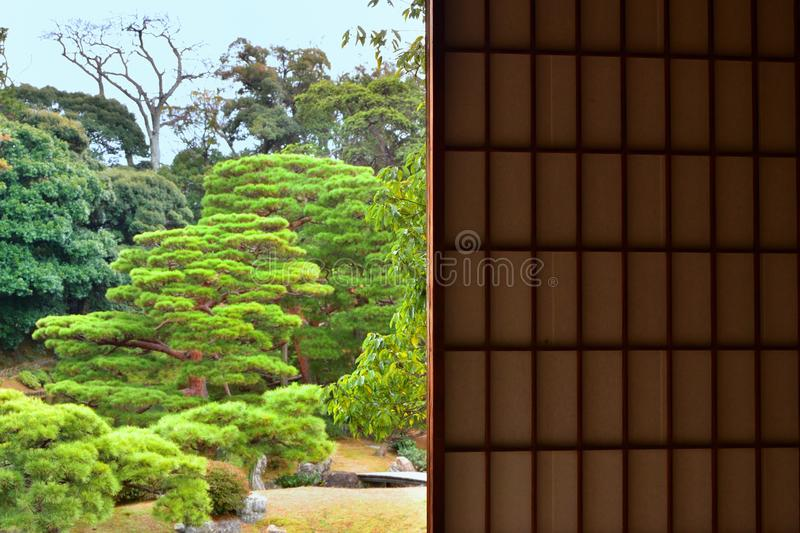 Peaceful Japanese garden from paper window, Japan stock photography