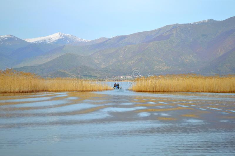Peaceful lake. Beautiful lakescape with a fishing boat in Prespes region, Greece stock photos