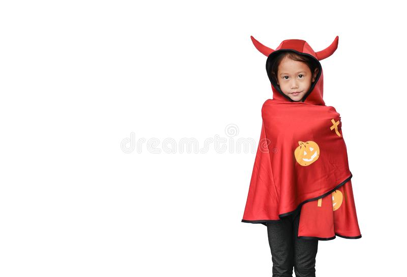 Peaceful little Asian child girl dressed Halloween costume. Kid in Dracula robe isolated on white background with copy space royalty free stock images
