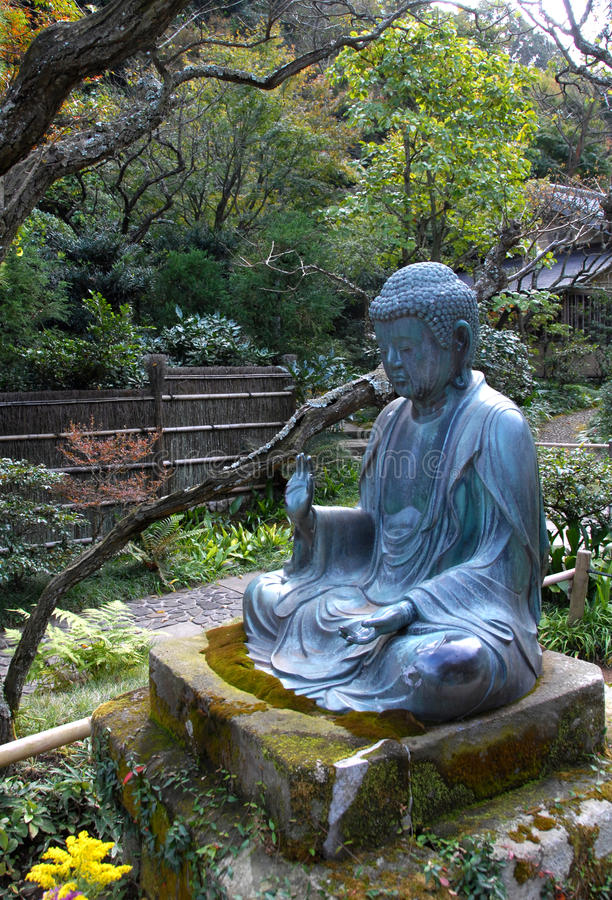 Peaceful meditation in the garden. Buddhas path toward enlightment stock photos