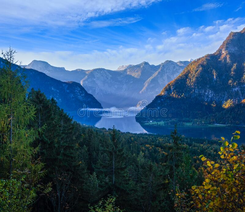 Peaceful morning autumn Alps mountain lake with clear transparent water and reflections. Hallstatter lake, Upper Austria. Idyllic morning colorful autumn alpine stock photos