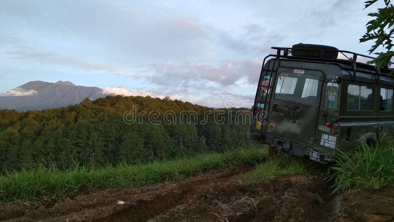 Peaceful mountain and off road vehicle stock photo