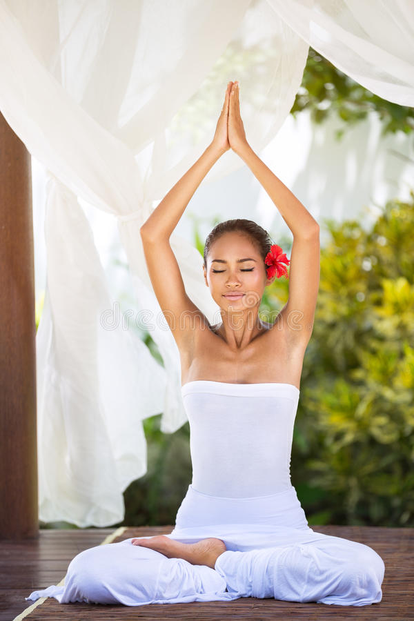 Peaceful natural woman in practicing yoga in bright nature stock images