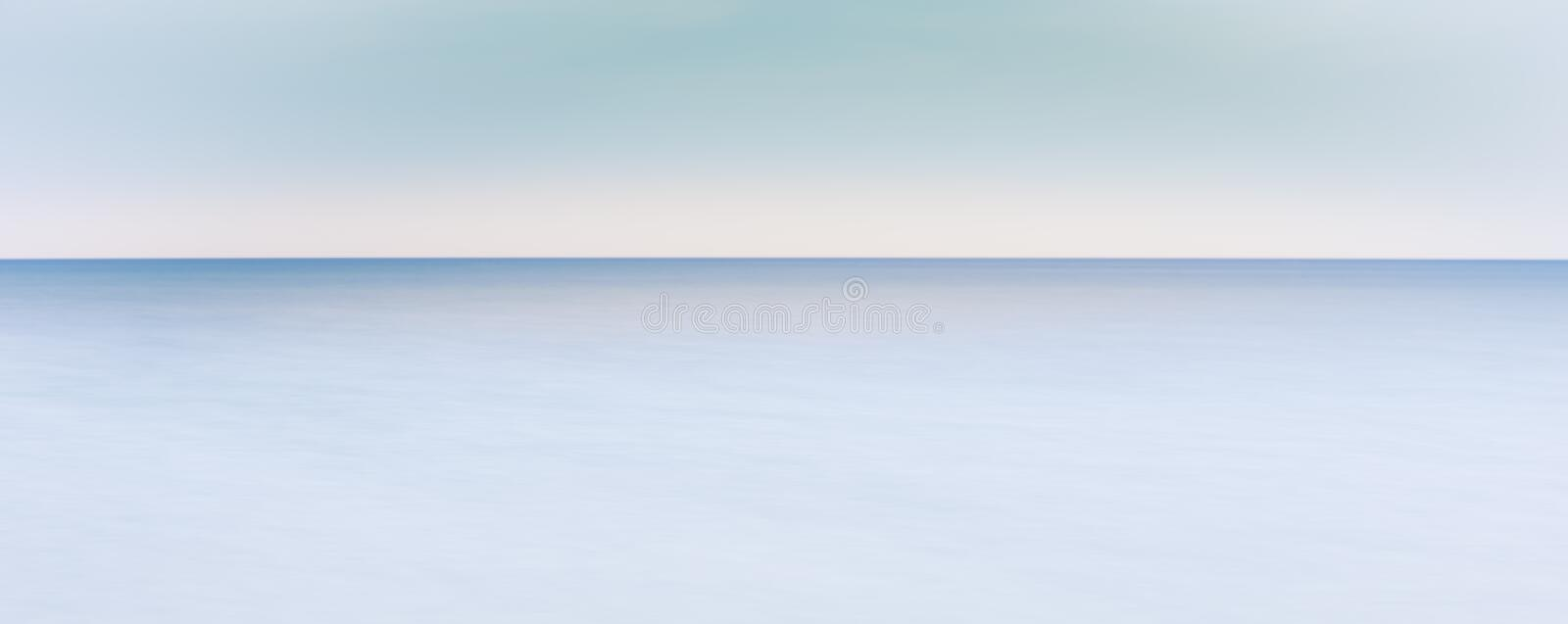 Peaceful ocean horizon - where horizon line meets sea royalty free stock image