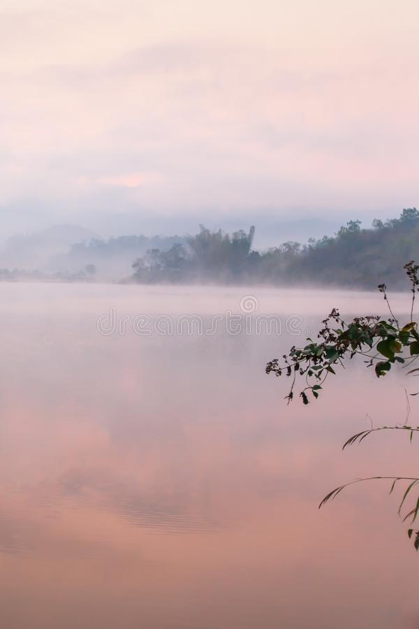 Peaceful place, Pa Khong Lake in morning light in summer season, soft mist covers on the lake and mountains backgrounds. Scenic. Landscape of Dien Bien District royalty free stock photography