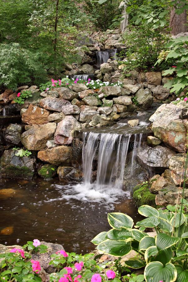 Peaceful Pond & Waterfall royalty free stock photography