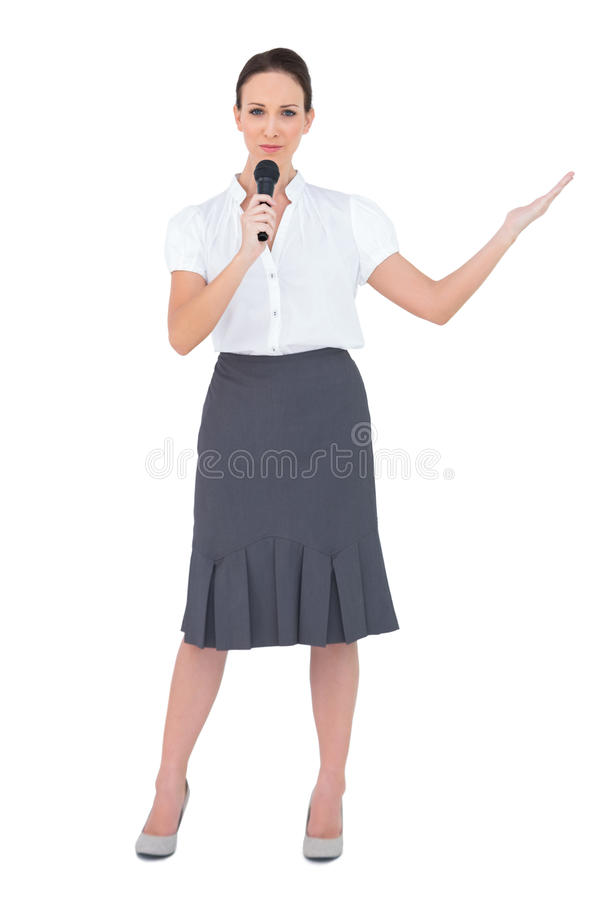 Peaceful presenter holding microphone stock photo