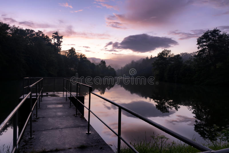 Peaceful, Purple Sunset with Dramatic Clouds on Stuttgart Bärensee. Reflected on Water royalty free stock image