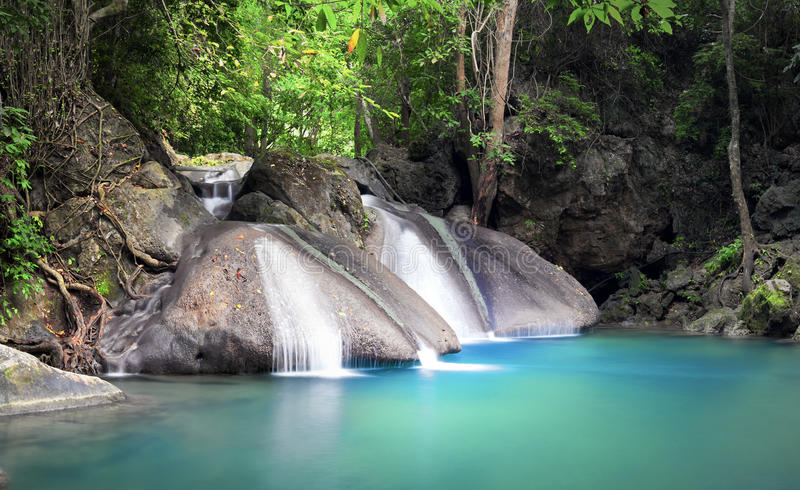 Peaceful and relaxing waterfall landscape of tropical forest. Peaceful and relaxing landscape background of tropical forest with small beautiful waterfall royalty free stock photography