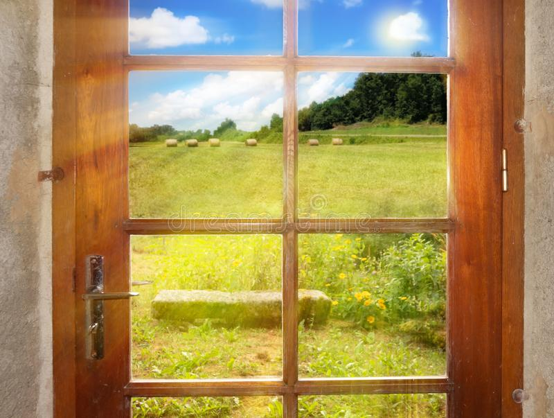 A peaceful rural landscape outside the rustic-style doors stock images