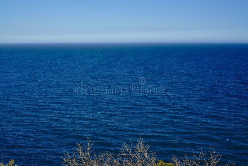Peaceful sea with blue sky in background royalty free stock images