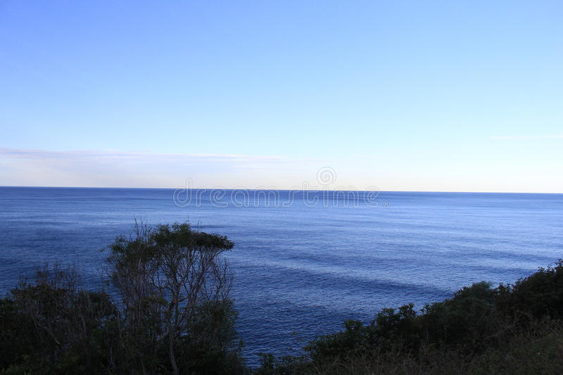 Peaceful Sea and Horizon. Calm deep blue Sea Water, and horizon line at evening light stock photography