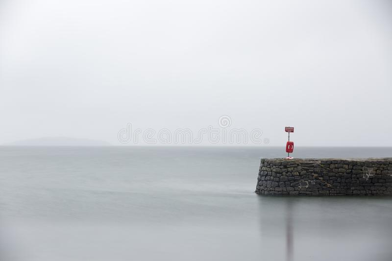 Peaceful serene jetty at dawn royalty free stock images