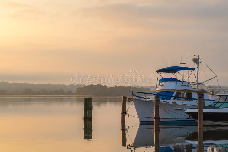 Peaceful sunrise along the Potomac - Alexandria VA harbor boats - misty serenity royalty free stock photos