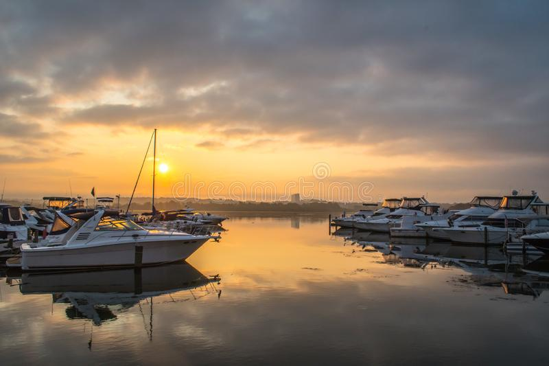 Peaceful sunrise along the Potomac - Alexandria VA harbor boats royalty free stock images