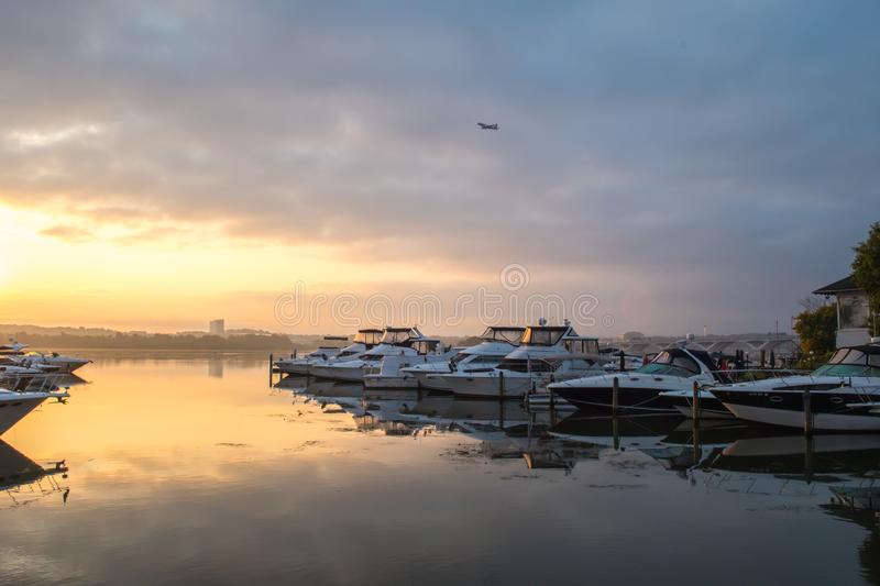 Peaceful sunrise along the Potomac - Alexandria VA harbor boats royalty free stock photos
