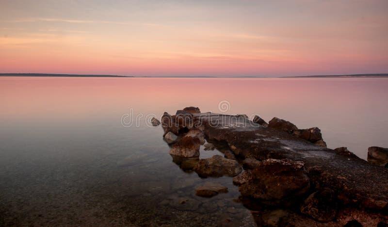 Sunrise Croatia Beach with Pastel Color Rocky Jetty stock photos