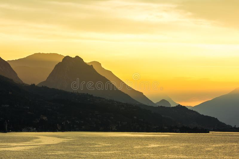Peaceful sunset looking out over the lake from Maraschina toward the mountains stock photo