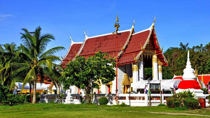 Peaceful Thai temple Wat Phai Lom and its chedi. Beautiful Thai temple Wat Phai Lom and its chedi wrapped with red fabrics set in peaceful environment in stock photo