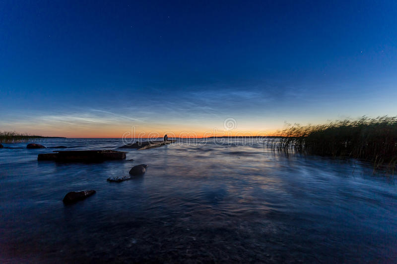 Peaceful twilight over sea with old broken jetty stock photos