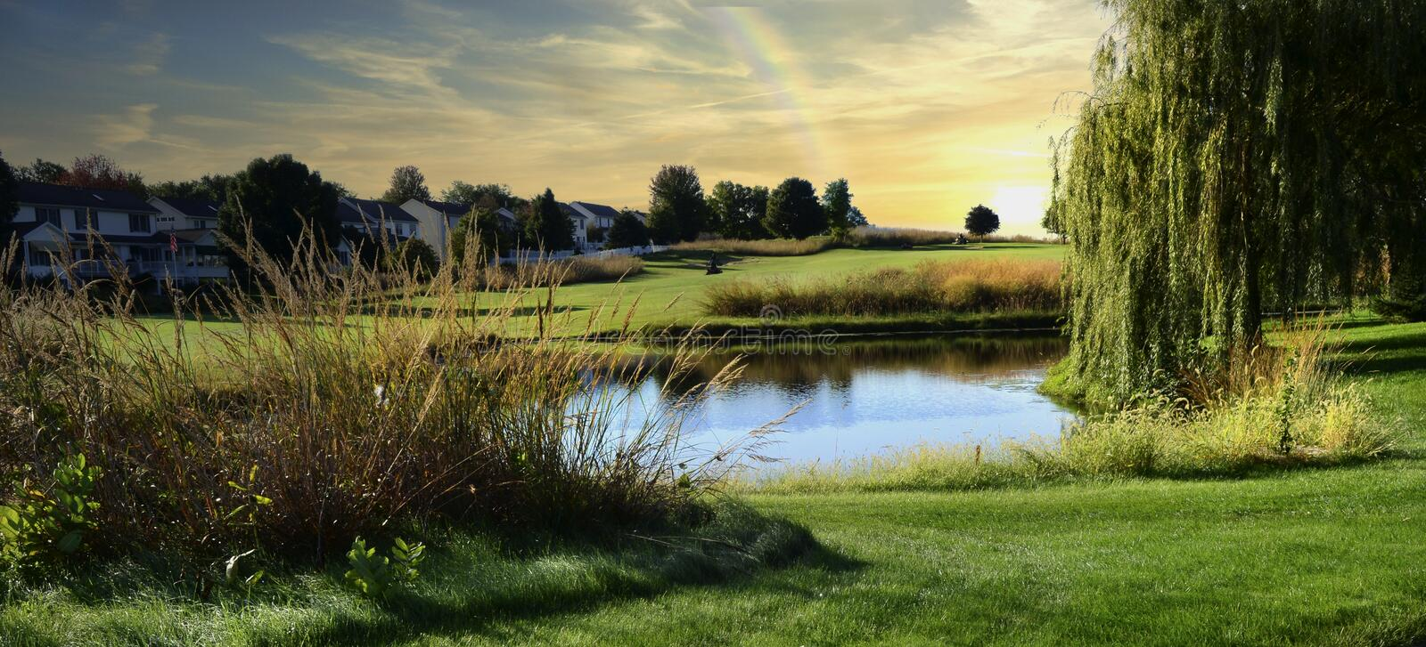 Peaceful view of a golf course during sunset royalty free stock image