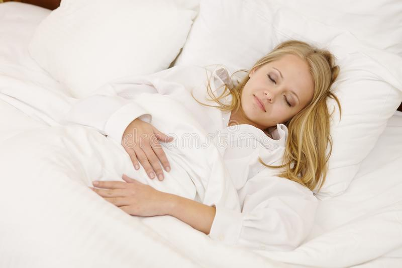 Download Peaceful Woman Lying In Bed Resting At Home Stock Photo - Image: 20091740