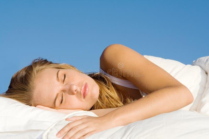Peaceful woman sleeping stock photography