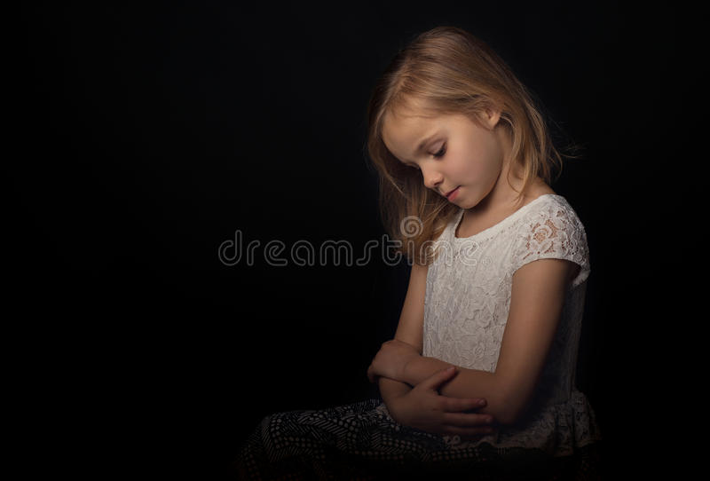 Peaceful. A young girl looking peaceful royalty free stock photos
