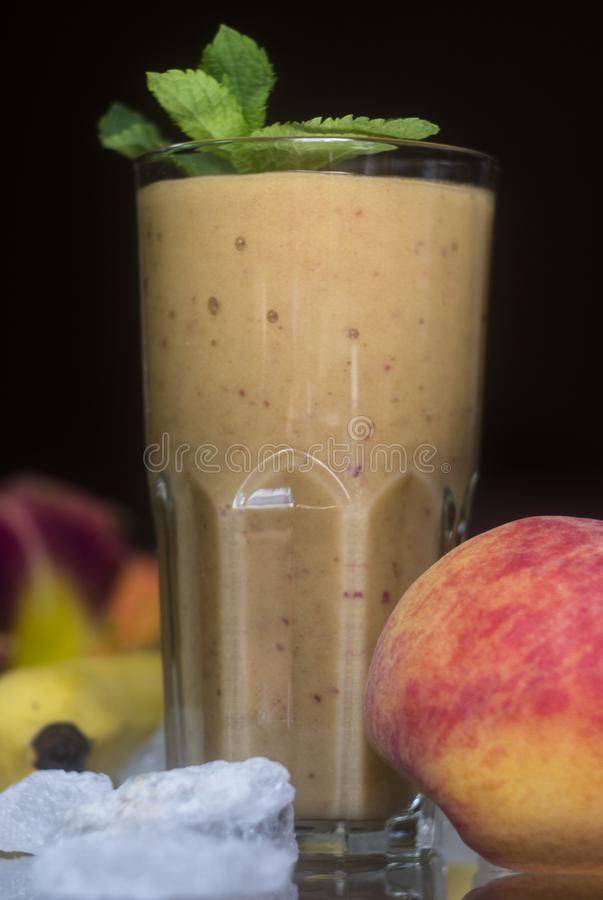 Peach banana smoothies royalty free stock photography
