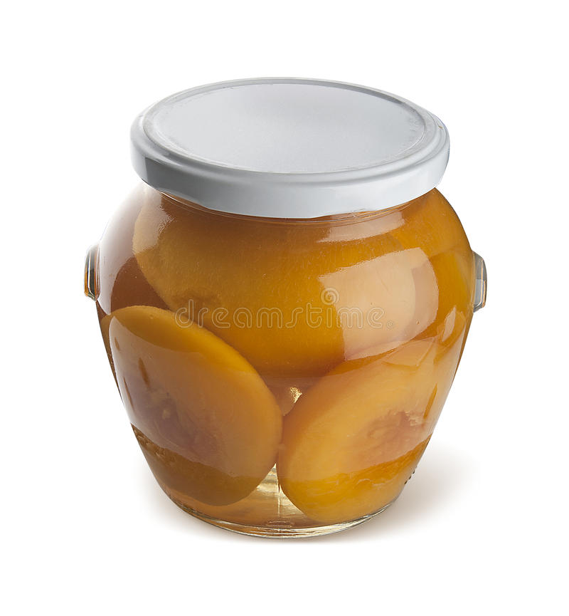 Peach compote. With peaches in the glass jar stock images