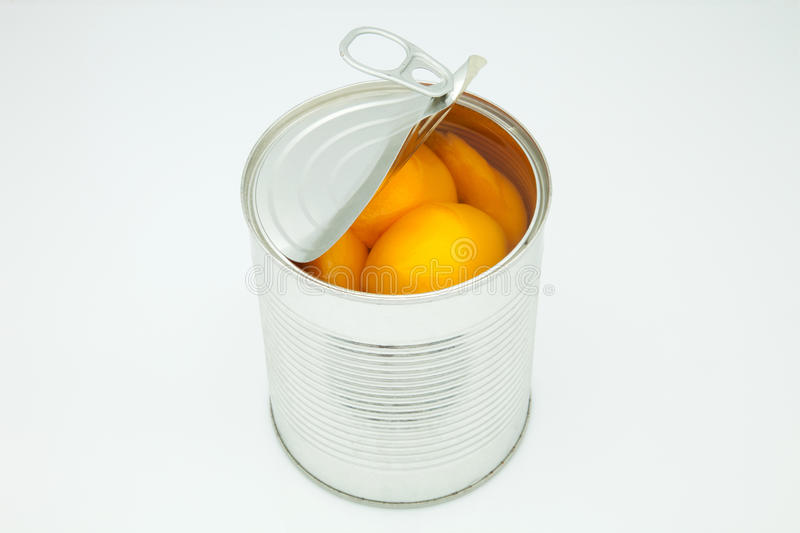 Peach in conserve. In a silver canister stock images