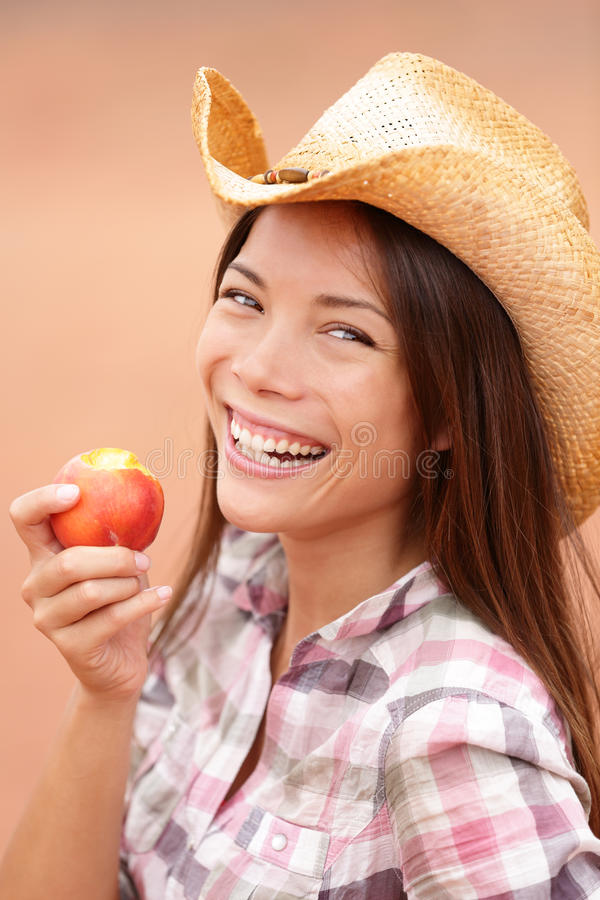 Peach eating cowgirl happy portrait stock photo