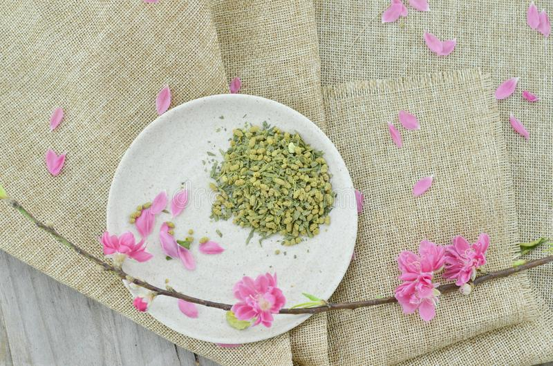 Peach flower and white plate with rice tea royalty free stock photography