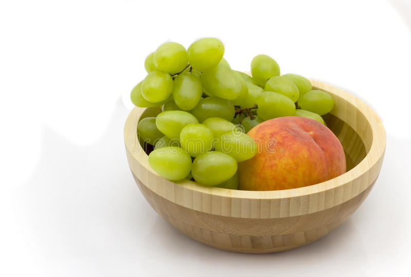 Peach and grapes royalty free stock photography