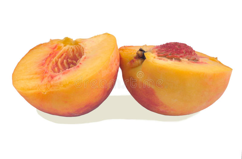 Peach, halves on a white background royalty free stock photos