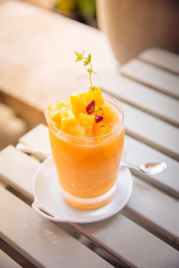 Peach juice blended into a glass jar or Peach smoothie Decorated. Peach juice blended into a glass jar. Decorated with Peach on wood table with spoon stock photos