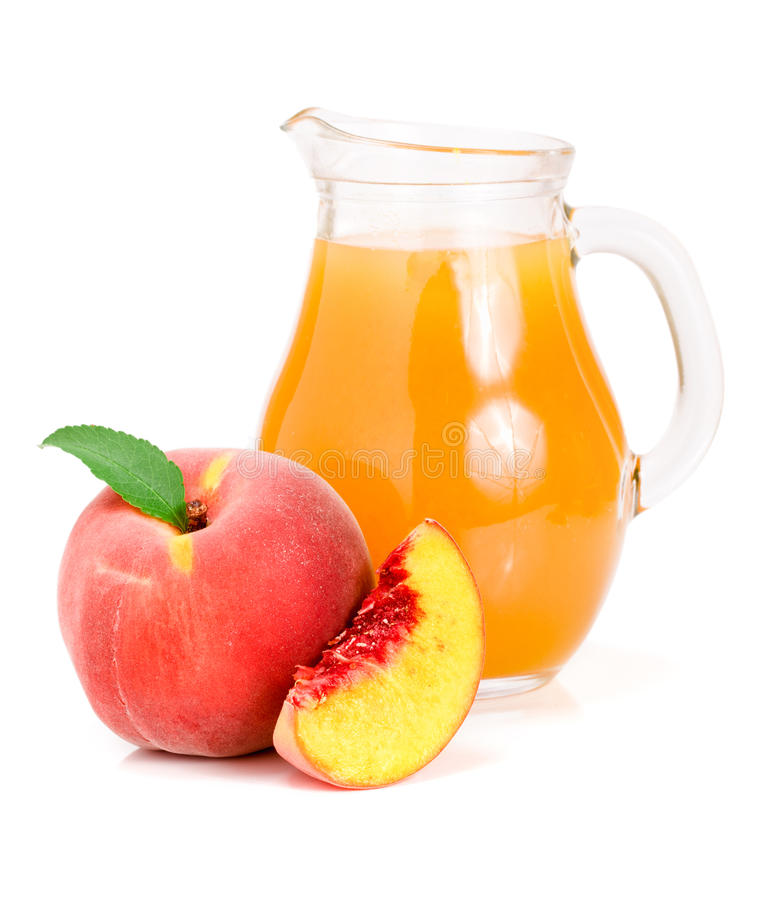 Peach juice in a glass jug isolated on white background stock image