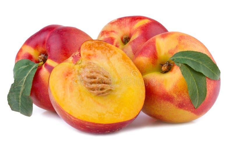 Peach or nectarine on white stock photos