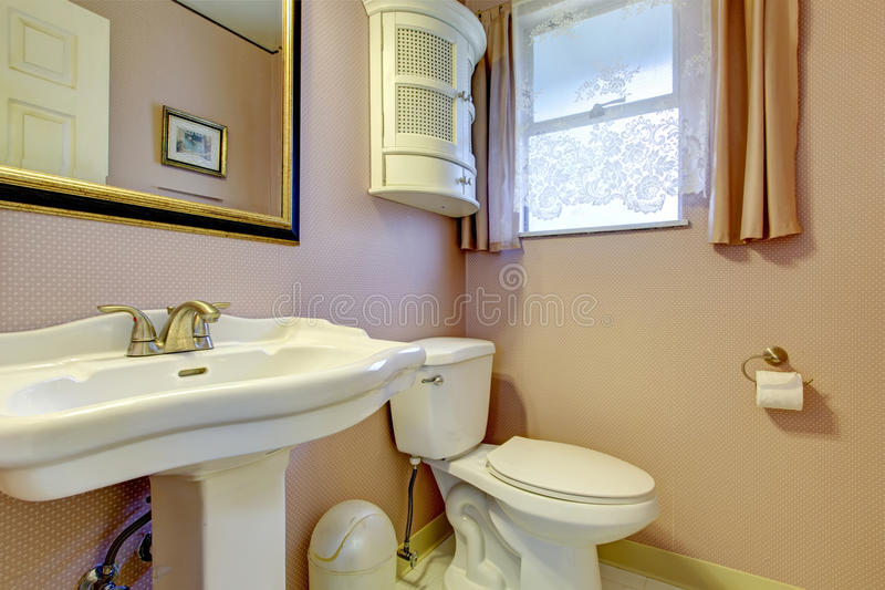 Peach old fashion bathroom with a window royalty free stock photos