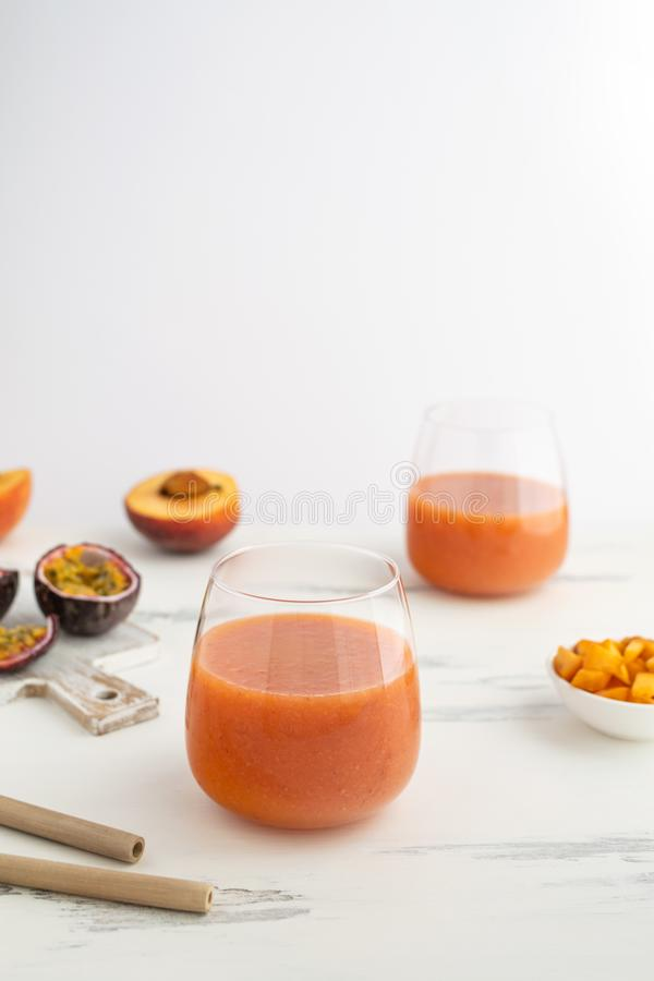 Peach and passion fruit smoothie with bamboo drinking straw. Sustainable lifestyle, plastic free - peach and passion fruit smoothie with bamboo drinking straw royalty free stock images