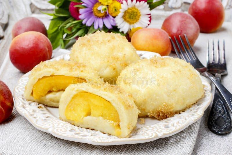 Peach in pastry, popular austrian dish stock photos