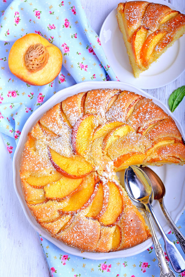 Peach pie. On white plate royalty free stock photos