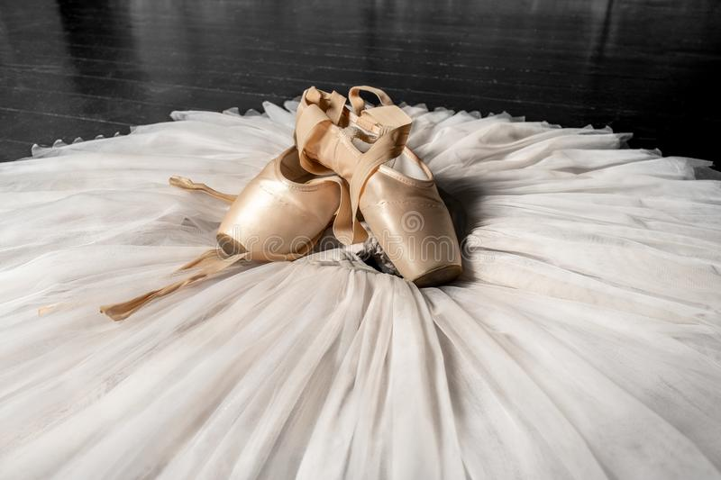 Pointe shoes and ballet tutu. Professional ballerina outfit. stock photos