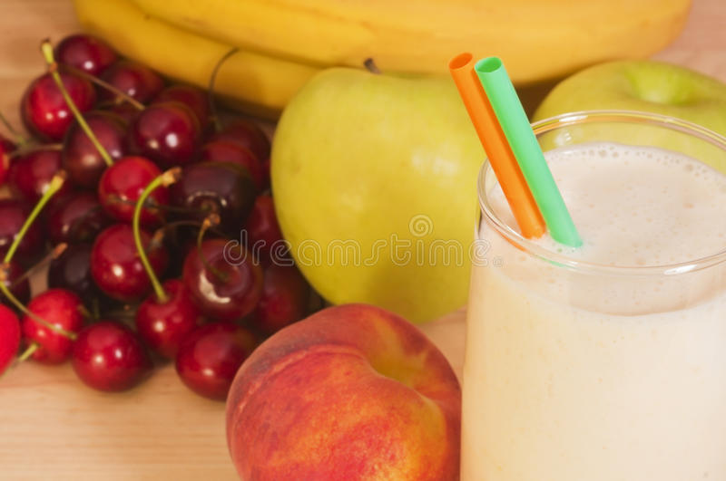Peach smoothie on wooden background royalty free stock photo