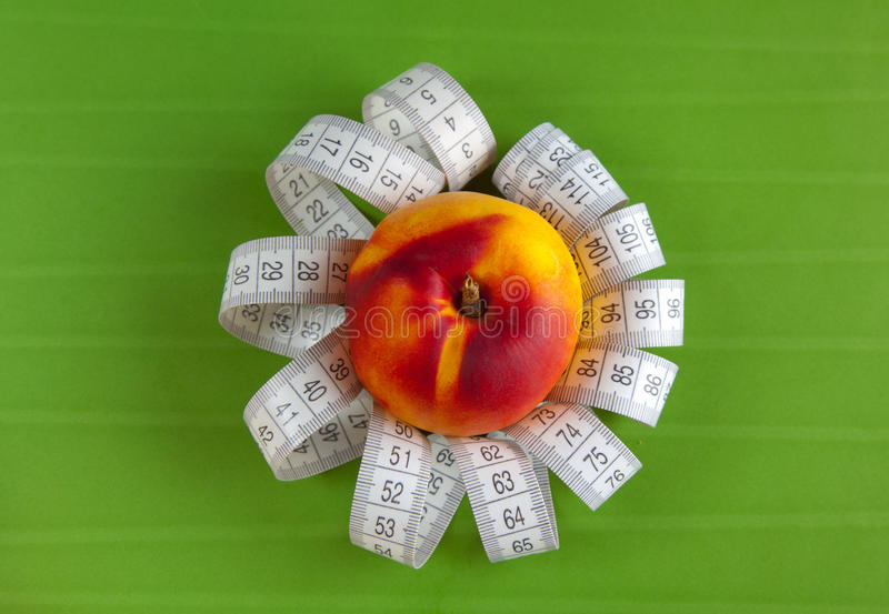Download Peach And Tape Measure On The Green Background Stock Image - Image of fleshy, food: 16322901