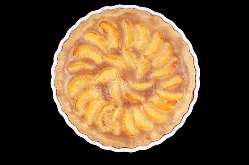 Peach tart in a white pottery cake tin stock photo