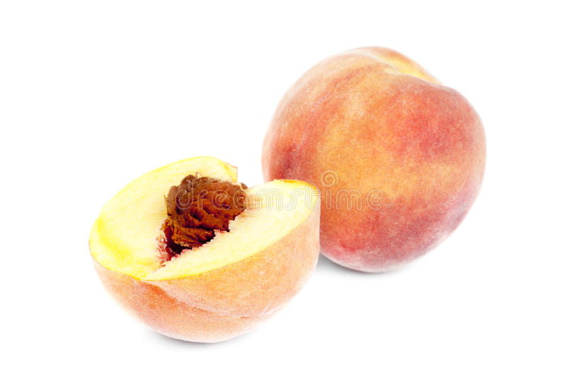 Peach on a white background stock photos