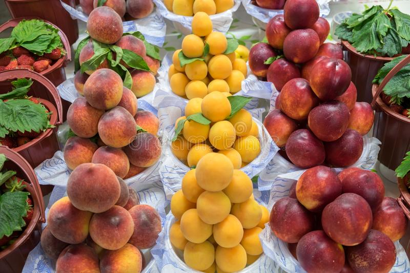 Peaches, apricots and nectarines for sale at city market. stock image